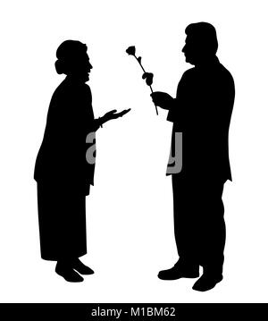 An elderly man gives a rose to an elderly woman - Stock Photo