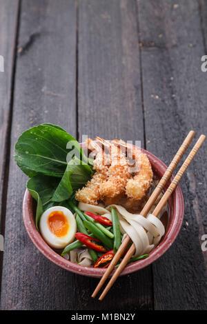 Tempura shrimps with asian noodle soup in a bowl - Stock Photo