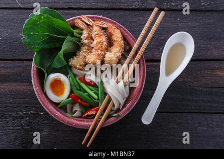 Bowl of delicious noodle soup with prawns - Stock Photo