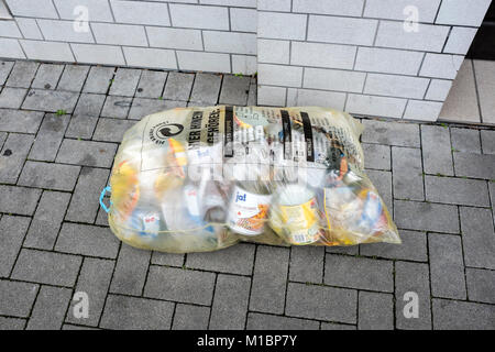 Plastic and packaging separated in a characteristic yellow bag, Ludwigshafen, Germany - Stock Photo