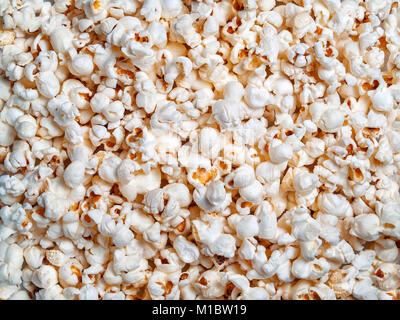 Ready popcorn of corn grains textural background close-up on top - Stock Photo