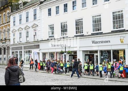 A large group of schoolchildren walking in Boscawen Street in Truro City Centre Cornwall. - Stock Photo