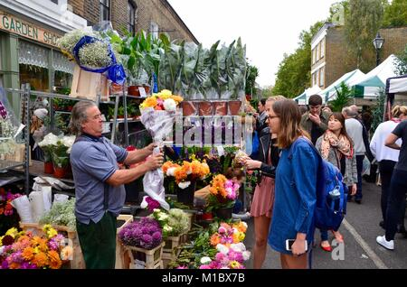columbia road flower market east london UK on a sunny sunday 2017 - Stock Photo
