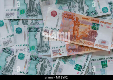 Money in Russia. Banknotes five and one thousand rubles. - Stock Photo
