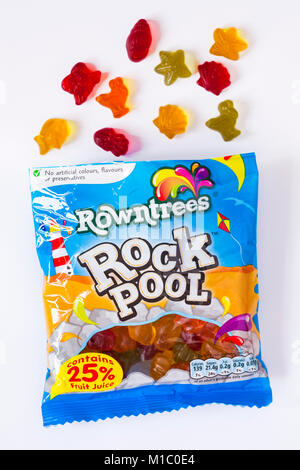 Packet of Rowntrees Rock Pool sweets open with contents spilled spilt isolated on white background - Stock Photo