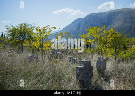 Christian Cemetery with Mountain Backdrop in Mostar, Bosnia and Herzegovina - Stock Photo