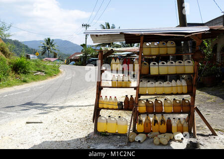 A small shop in Northern Sumatra selling bottles of gasoline, Indonesia. - Stock Photo