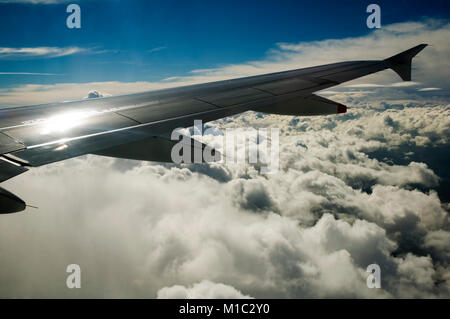 Clouds during flight from Manchester to Charles de Gaulle Airport - Stock Photo