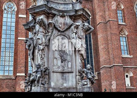 John of Nepomuk ( St John Nepomucen) monument on square of Collegiate church of the Holy cross and St Bartholomew - Stock Photo