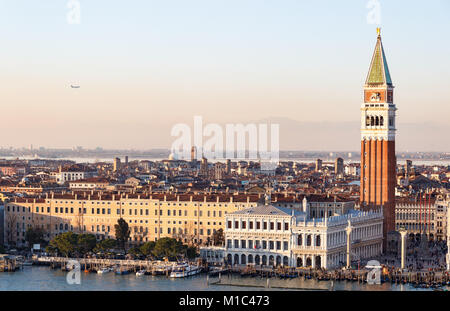 VENICE, ITALY - DECEMBER 20, 2017: Aerial view of Venice with the San Marco bell tower in sunset - Stock Photo