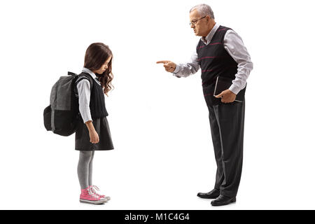 Full length profile shot of an old teacher scolding a schoolgirl isolated on white background - Stock Photo