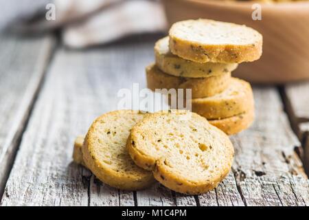 Crusty bread bruschetta on old wooden table. - Stock Photo