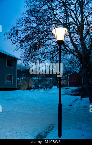 Twilight image during a winter day in Nockeby, Bromma, one of Stockholm's suburbs - Stock Photo