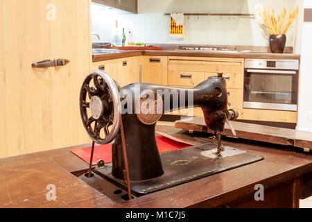 home interior modern beautiful apartment in new luxury location. vintage sewing machine in the foreground - Stock Photo