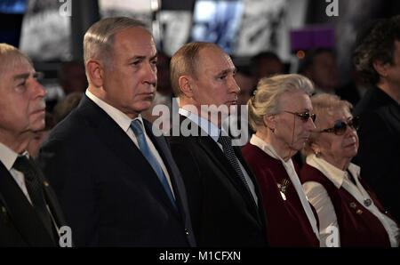 Russian President Vladimir Putin stands with Israeli Prime Minister Benjamin Netanyahu, left, during an event marking - Stock Photo