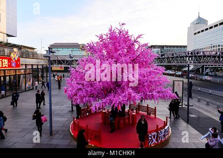 Beijin, Beijin, China. 26th Jan, 2018. Beijing, CHINA-26th January 2018: Artificial peach blossoms can be seen during - Stock Photo
