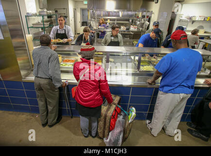 Houston, Texas, USA. 28th January, 2018. Beto O'Rourke, D-Texas serves a warm meal at The Beacon homeless shelter - Stock Photo
