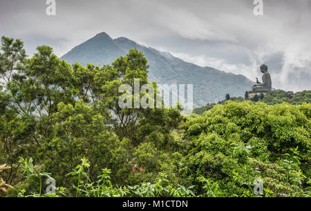 Hong Kong Buddha in mountains of Lan tau Island. - Stock Photo