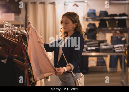 Beautiful woman shopping for clothes Stock Photo