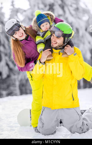 Happy family during the winter vacations - Stock Photo