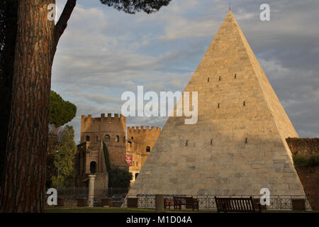 Pyramid of Cestius (12 BC)  and Porta San Paolo: view from the Protestant Cemetery - Stock Photo