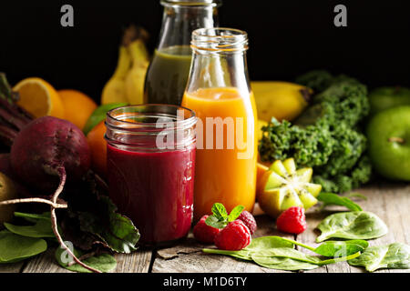 Fresh vegetable and fruit juices with beets, berries and greens - Stock Photo