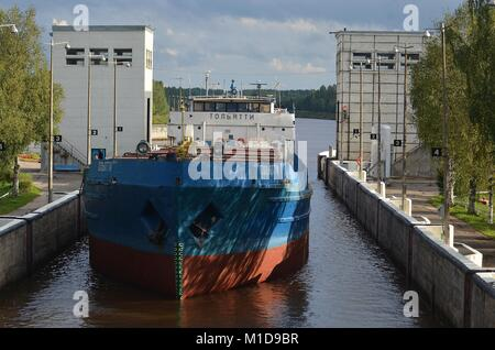 FREIGHTER 'TOLYATTI'  IN LOCK 1 ON THE KOVZHA RIVER BOUND FOR LAKE LADOGA, RUSSIA. - Stock Photo