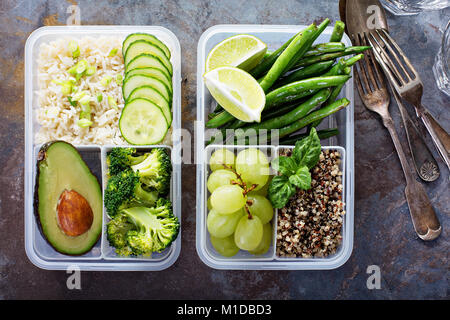 Vegan green meal prep containers with rice and vegetables - Stock Photo