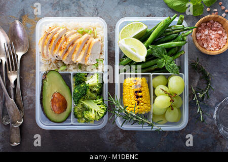 Healthy green meal prep containers with rice and vegetables - Stock Photo