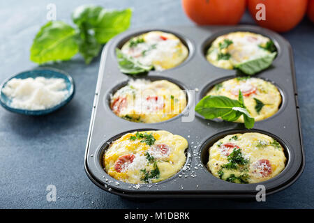 Healthy egg muffins, mini frittatas with tomatoes - Stock Photo