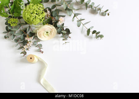 Feminine wedding, birthday desktop mock-up scene. Blank paper greeting card and bouquet of eucalyptus branches, - Stock Photo