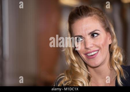 Portrait of a beautiful blonde woman - Stock Photo