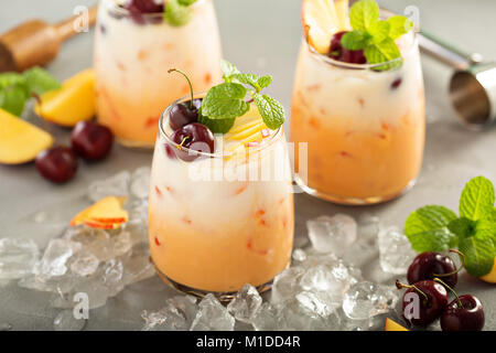 Summer cherry and peach coconut milk cocktail - Stock Photo