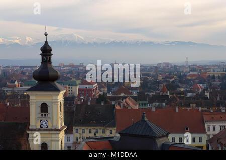 Town of Sibiu and the Carpathian Mountains in Romania - Stock Photo