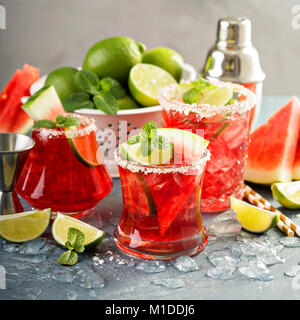 Watermelon margarita with limes - Stock Photo