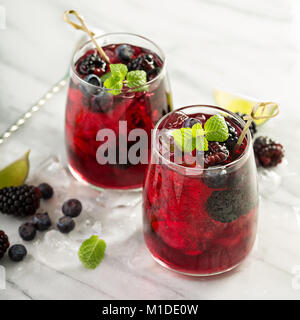 Summer berry drink with lime - Stock Photo