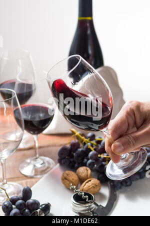 Professional red wine tasting event with high quality wine glasses and wine accessories close up - Stock Photo