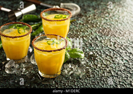 Spicy mango margaritas with hot pepper - Stock Photo
