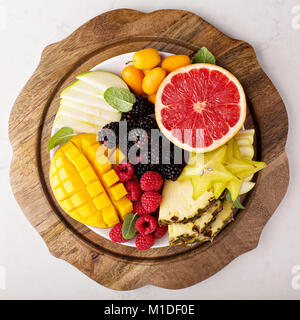 Fruit plate with mango, grapefruit and berries - Stock Photo