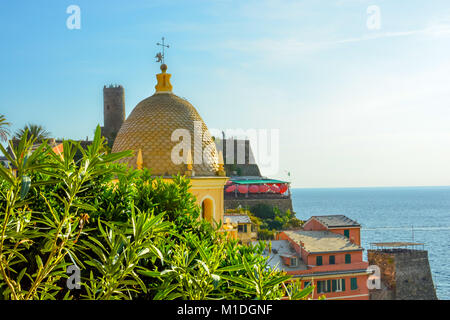 Tourists enjoy a beautiful view of the Ligurian Sea at the village of Vernazza Italy, part of the Cinque Terre, - Stock Photo