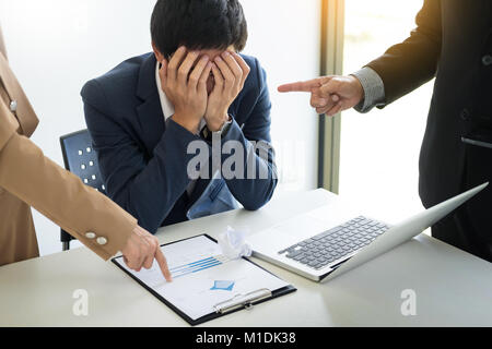 Group Of Angry Business people Blaming Male Colleague In Meeting for business mistake in office - Stock Photo