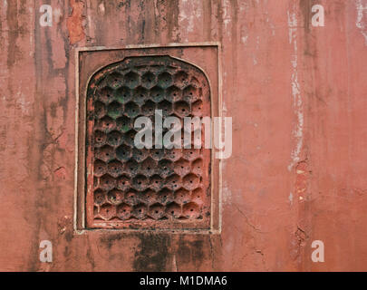 Red sand stone texture pattern on surface of the wall of ancient palace in Jaipur, India. - Stock Photo