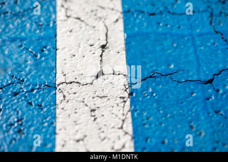 Abstract, blue background of newly made outdoor basketball court in park. Visible asphalt texture, freshly painted - Stock Photo