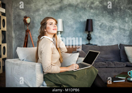 Young Designer Woman Sitting at Home Office Desk with Laptop. Attractive Cheerful Model Using Computer. Girl Working - Stock Photo