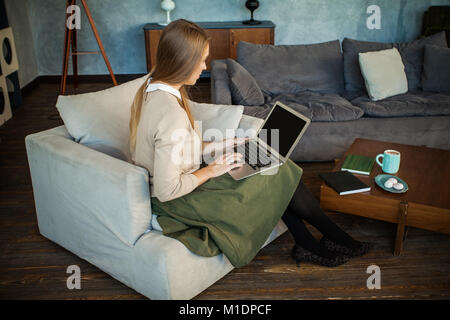 Nice Woman Using Laptop at Home Office - Stock Photo