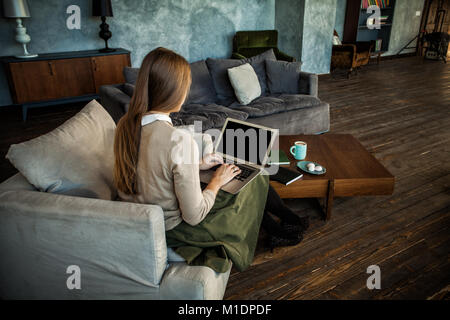 Empty Screen Laptop in Female Hands at Home - Stock Photo