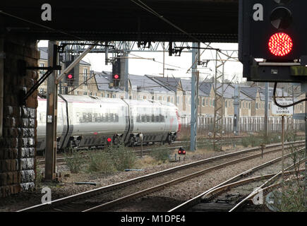 Class 390 Virgin West Coast Pendolino electric multiple unit train leaving Lancaster on the West Coast Main Line - Stock Photo