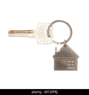 A house key on a house key ring on a white background - Stock Photo