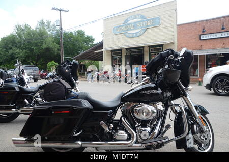 harley davidson motorcyles parked in the gruene street outside the general store texas USA - Stock Photo