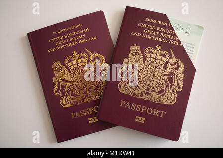 Two UK Passports, one cancelled and a renewal, UK. - Stock Photo